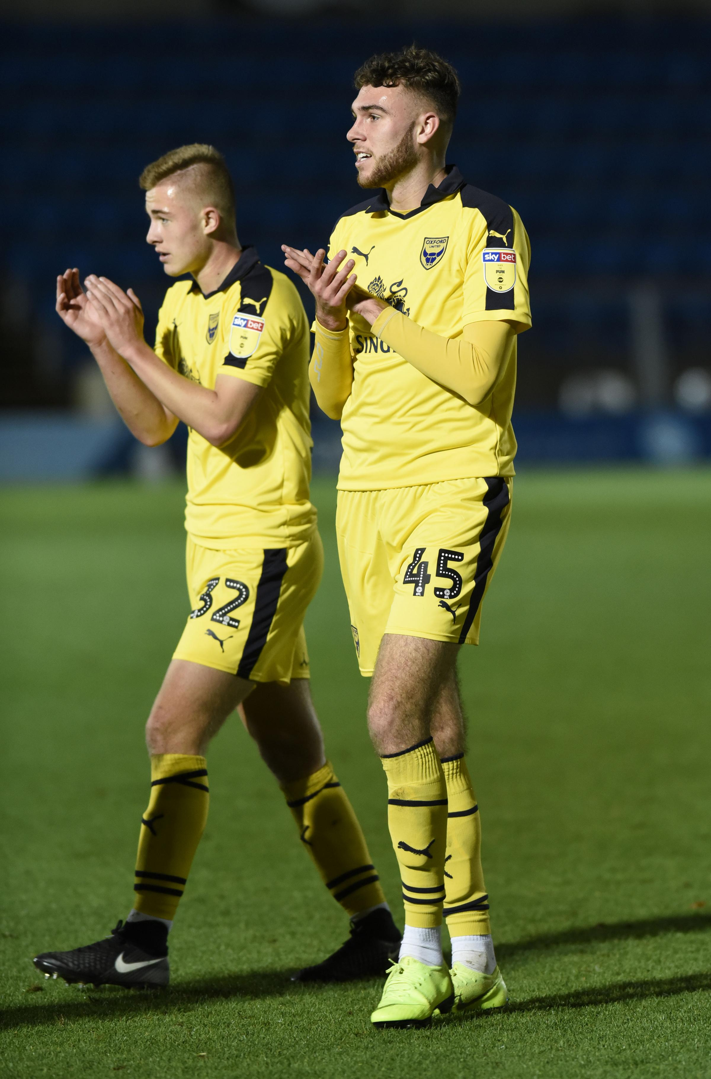 Aaron Heap (left) and Harvey Bradbury applaud the Oxford United supporters after making their senior debuts in the win at Wycombe Wanderers on Tuesday night  Picture: David Fleming
