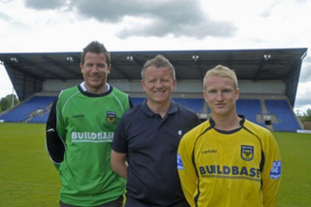 Banbury Cake: New signings Ryan Clarke (left) and Marcus Kelly with manager Chris Wilder