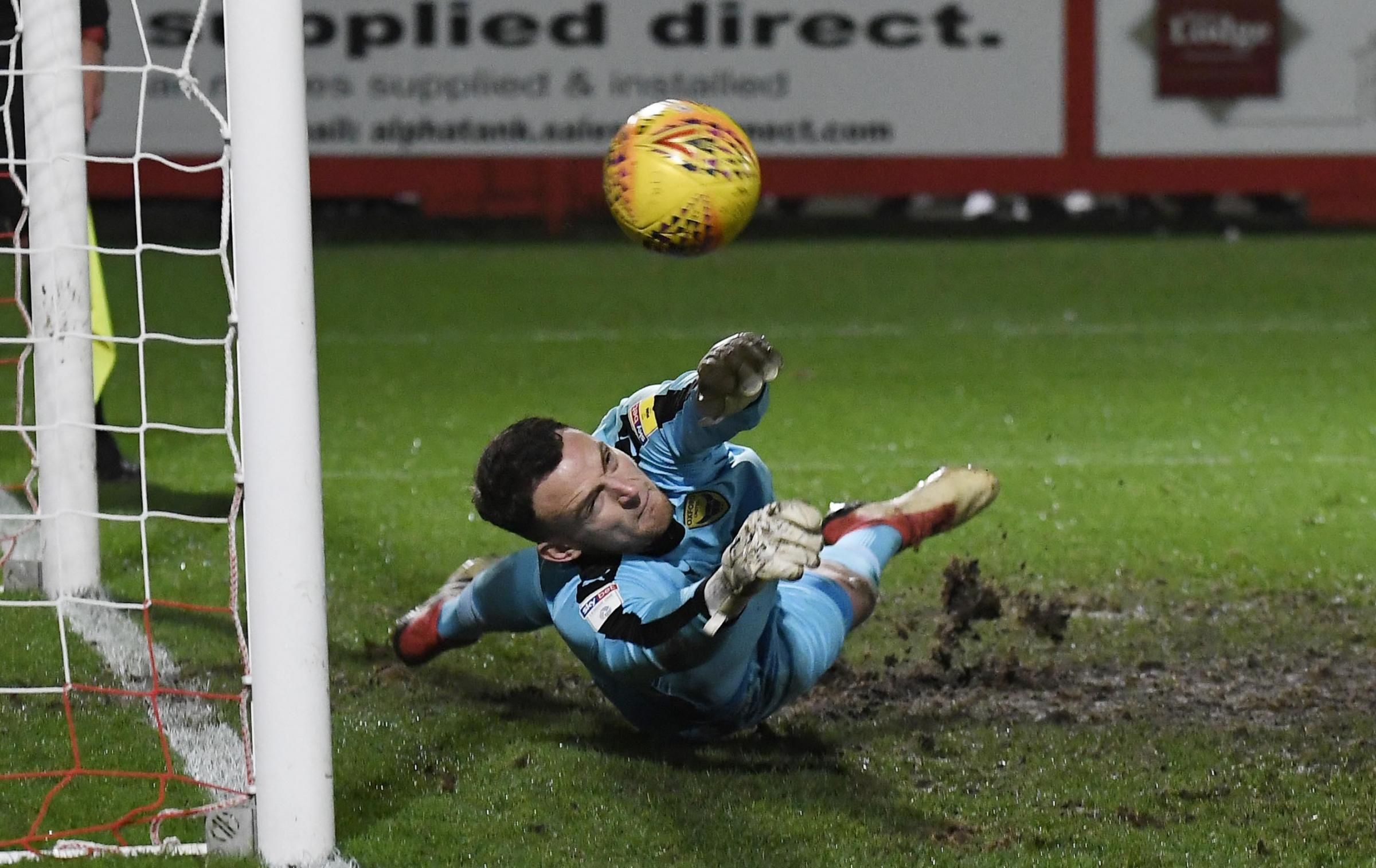 Simon Eastwood makes a save during the shoot-out win over Cheltenham in the previous round Picture: David Fleming