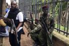 Security forces at the scene of a blast in Nairobi