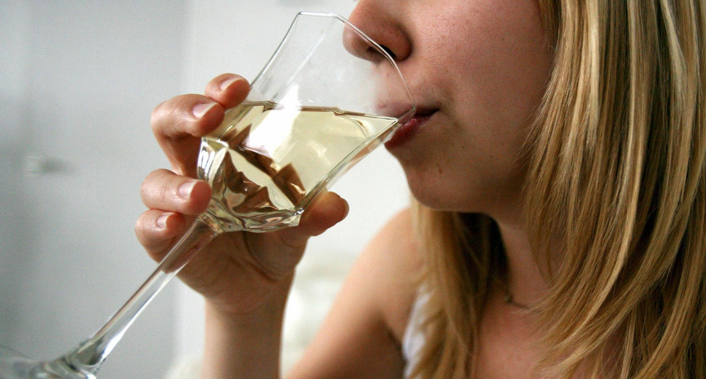 File photo of a woman having an alcoholic drink (white wine). Picture: Katie Collins/PA Wire.