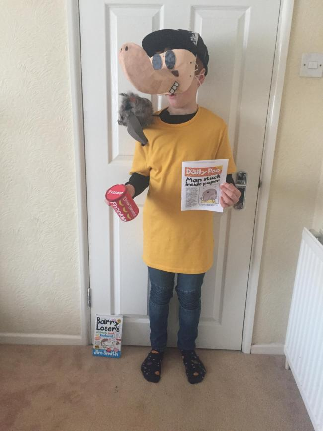 Connor is dressed up as Barry Loser by Jim Smith!  He has Not Bird perched on his shoulder, a copy of the Daily Poo and a can of Fronkle!