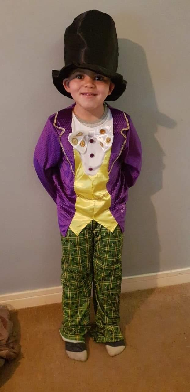 World book day 2019 Kai dressed up as Willy wonka from Charlie and the chocolate factory .