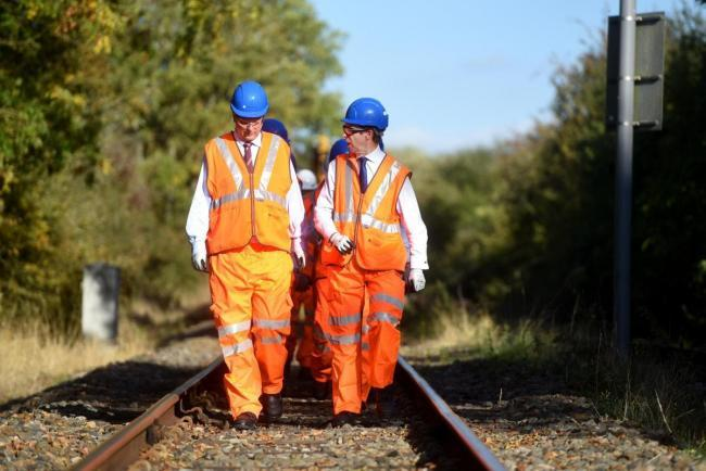 Transport secretary Chris Grayling (left) on a visit to East West Rail work near Bicester last year