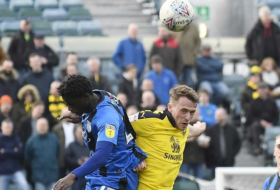 Sam Long challenges for an aerial ball against Gillingham  Picture: David Fleming
