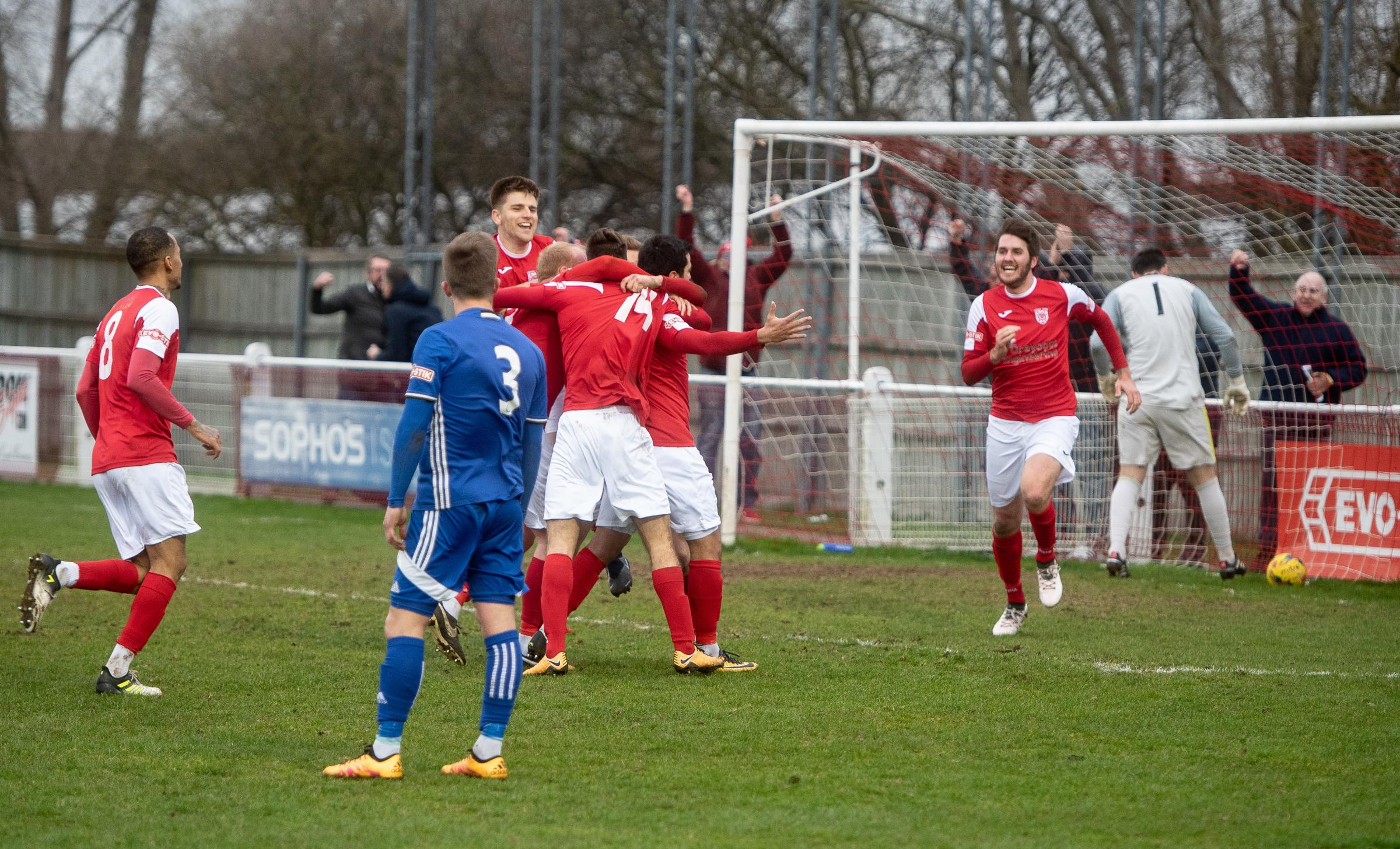 Didcot Town's players celebrate the dramatic injury-time goal from Felipe Barcelos which rescued a point against Peterborough Sports, who had taken the lead through Dion Sembie-Ferris Picture: Richard Cave