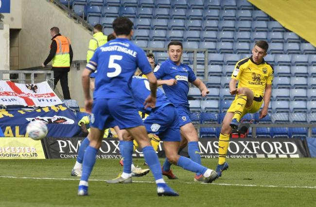 Cameron Brannagan fires a first-half shot which hit the post against AFC Wimbledon  Picture: David Fleming