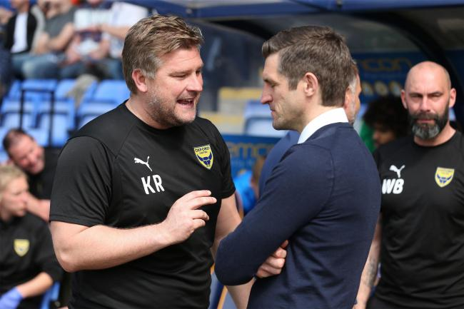 Karl Robinson chats with Shrewsbury boss Sam Ricketts when the sides met in April  		                   Picture: Richard Parkes