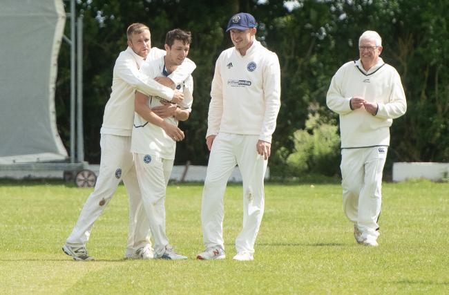 Hanborough's Ben Howsie is congratulated after a wicket in their OCA game against Wootton & Boars Hill Picture: Richard Cave